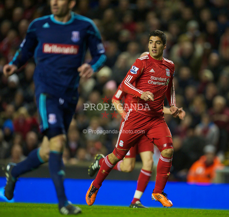 LIVERPOOL, ENGLAND - Wednesday, February 2, 2011: Liverpool's Luis Alberto Suarez Diaz in action against Stoke City during the Premiership match at Anfield. (Photo by David Rawcliffe/Propaganda)