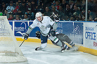 KELOWNA, CANADA - NOVEMBER 26: Turner Ottenbreit #4 of Seattle Thunderbirds slides into the boards with a player of the Kelowna Rockets on November 26, 2015 at Prospera Place in Kelowna, British Columbia, Canada.  (Photo by Marissa Baecker/Shoot the Breeze  *** Local Caption *** Turner Ottenbreit;