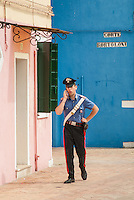 carabinieri on cell phone in Burano, Italy