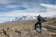 A hiker takes a photograph in Torres del Paine National Park, Chile.