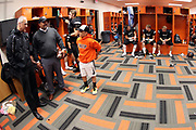 Erie Cathedral Preparatory School President Fr. Scott Jabo visits the locker room before the Erie Cathedral Prep Ramblers 2017 high school football game against the against the Cleveland Benedictine Bengals, Friday, Sept. 15, 2017 in Erie, Pa. The Ramblers won the game 62-28. (©Paul Anthony Spinelli)