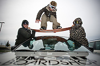 JEROME A. POLLOS/Press..Kyle Olsen, center, a team rider for Merit Boardshop, is supported by Jason Shaddruck, left, owner of Merit Boardshop, and Justin Doty.