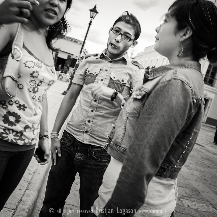 Young people chating in the street of Oaxaca