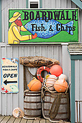 Quirky sign for a Fish & Chips shop along the marsh boardwalk on Homer Spit on Kamishak Bay in Homer, Alaska.