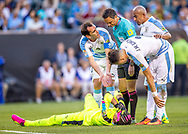 Uruguayan defender and national team captain Diego Godin complains to the referee about a challenge over goalkeeper Fernando Muslera as teammates Jose Maria Gimenez and Arevalo Rios check on him during the first half of a group stage match of the Copa America Centenario against Venezuela at Lincoln Financial Field in Philadelphia, Penn., on Friday June 9, 2016.