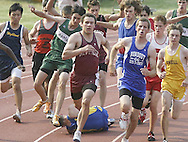 Runners try to avoid another athlete who fell at the start of the 800-meter run during the Section 9 Class B championship meet at Dietz Stadium in Kingston on May 25, 2007. Officials restarted the race.