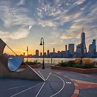 Jersey City with the famous sun dial and New York City skyline photographed on a quiet morning at sunrise. <br /> <br /> This Jersey City photography image is available as museum quality photography prints, canvas prints, acrylic prints or metal prints. Prints may be framed and matted to the individual liking and decorating needs: <br /> <br /> https://juergen-roth.pixels.com/featured/jersey-city-sun-dial-and-nyc-skyline-juergen-roth.html<br />  <br /> Good light and happy photo making!<br /> <br /> Juergen<br /> Prints: http://www.rothgalleries.com<br /> Photo Blog: http://whereintheworldisjuergen.blogspot.com<br /> Twitter: @NatureFineArt<br /> Instagram: https://www.instagram.com/rothgalleries<br /> Facebook: https://www.facebook.com/naturefineart