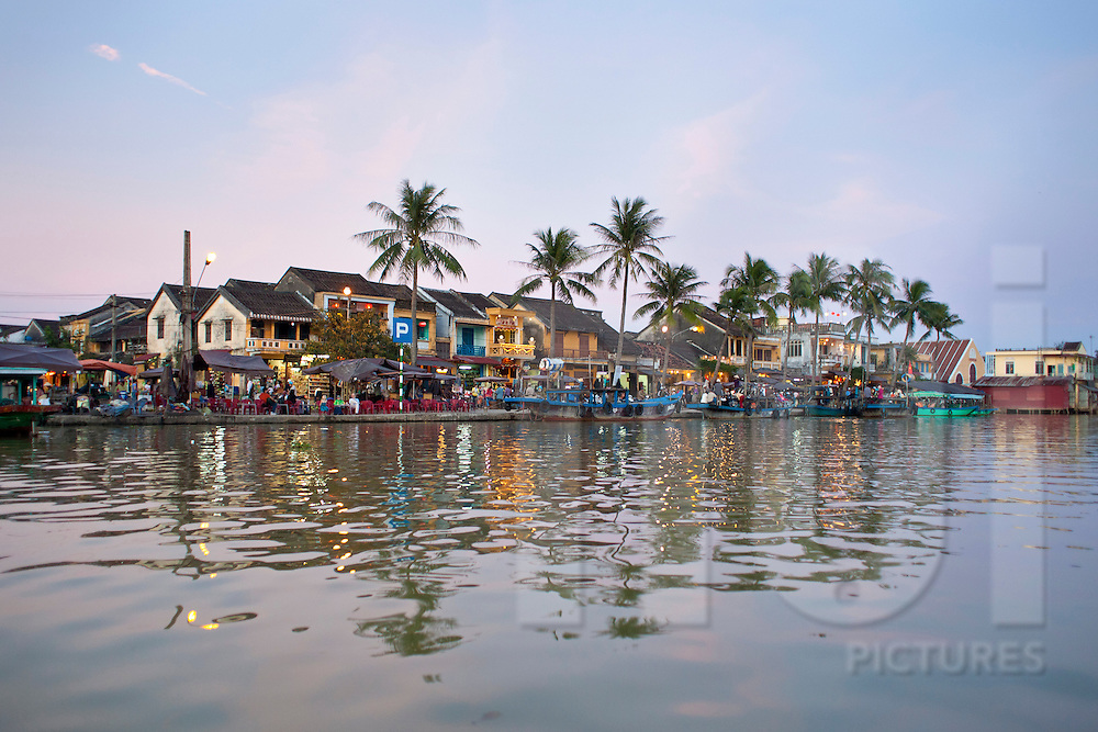 View from the river of Bach Dang street  at sunset in Hoi An, Vietnam, Asia