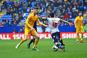 Preston North End Midfielder Paul Gallagher challenges Bolton Defender Mark Davies during the Sky Bet Championship match between Bolton Wanderers and Preston North End at the Macron Stadium, Bolton, England on 12 March 2016. Photo by Pete Burns.