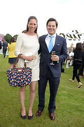 GEORGE FOX and his wife TAMARA FOX at the 2013 Cartier Queens Cup Polo at Guards Polo Club, Berkshire on 16th June 2013.