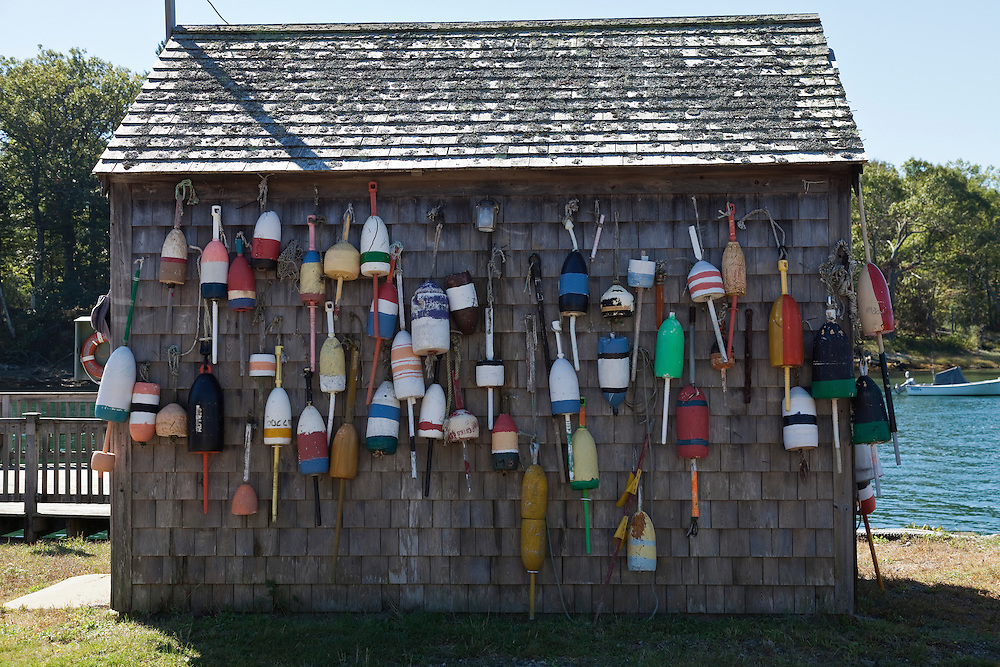 Colorful lobster buoys hung on side of lobster shack along York River