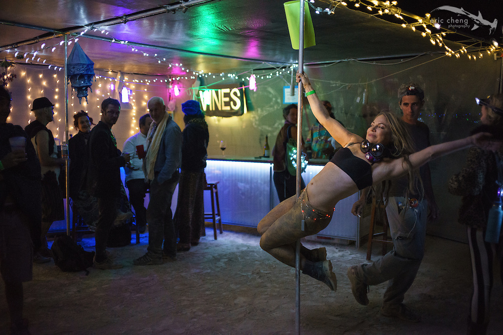 Casual pole dancing at Vines Without Borders. Burning Man 2014.