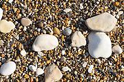 Pebbles and shingle on a beach along the Jurassic coast near Lulworth, Wareham, Dorset, UK