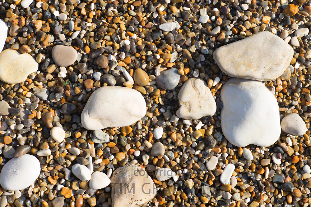 Pebbles and shingle on a beach along the Jurassic coast near Lulworth, Wareham, Dorset, UK