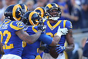 Dec 30, 2018; Los Angeles, CA, USA; Los Angeles Rams cornerback Aqib Talib (21) celebrates with teammates after intercepting the football at Los Angeles Memorial Coliseum. The Rams defeated the 49ers 48-31.  (Robin Alam/Image of Sport)