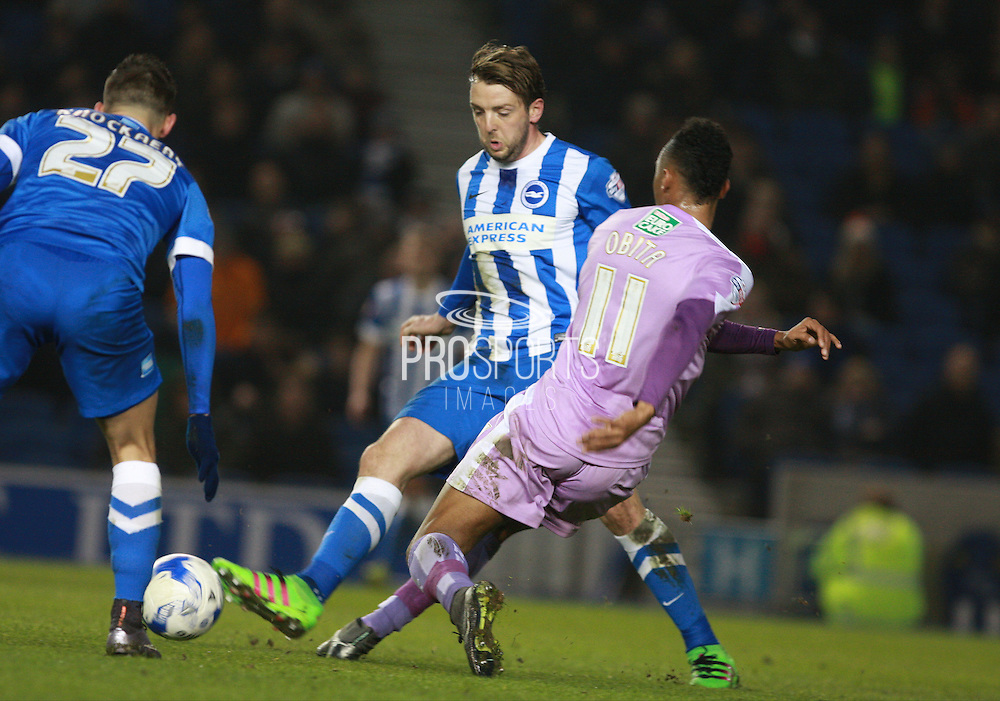 Brighton central midfielder Dale Stephens & Reading midfielder Jordan Obita compete for possession during the Sky Bet Championship match between Brighton and Hove Albion and Reading at the American Express Community Stadium, Brighton and Hove, England on 15 March 2016. Photo by Bennett Dean.