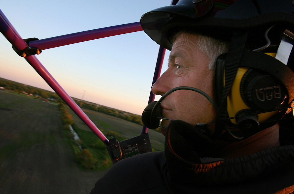 Bill Mauck flies around in his powered parachute Monday May 22 in Gaston..Photo by Chris Bergin....