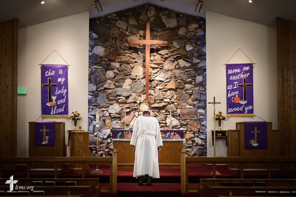 The Rev. Mark Nierman, pastor of Mount Olive Lutheran Church, bows before the altar following Lenten worship on Wednesday, March 2, 2016, in Loveland, Colo. LCMS Communications/Erik M. Lunsford
