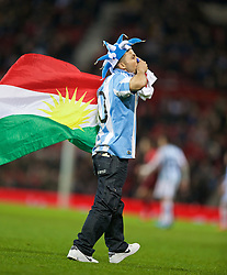 MANCHESTER, ENGLAND - Tuesday, November 18, 2014: An Argentina supporter runs onto the pitch with a flag of Kurdistan  during the International Friendly match against Portugal at Old Trafford. (Pic by David Rawcliffe/Propaganda)
