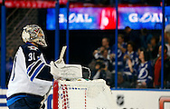 Winnipeg Jets goalie Ondrej Pavelec reacts after giving up his fifth goal of the game to the Tampa Bay Lightning during the second period of their NHL hockey game in Tampa, Florida February 1, 2013.  REUTERS/Mike Carlson (UNITED STATES)