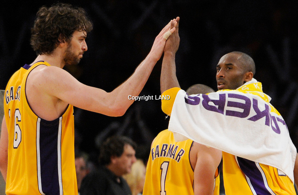 Pau Gasol gets a high five from Kobe Bryant after leaving the floor in the 4th quarter. The Lakers defeated the Boston Celtics in game 6 of the NBA Finals 89-67. Los Angeles, CA 06/15/2010 (John McCoy/Staff Photographer).