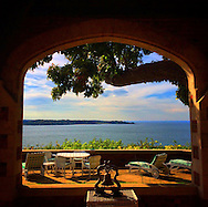 The covered patio of the Fort Hill House in Lloyd Harbor offers spectacular views of Centre Island and Long Island Sound, October 20, 2014.  This grand estate home is a monumental brick and limestone Tudor Revival style structure and is listed on the National Register of Historic Places. © Audrey C. Tiernan