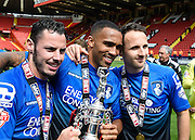 Bournemouth players pose with the Sky Bet Championship trophy after the Sky Bet Championship match between Charlton Athletic and Bournemouth at The Valley, London, England on 2 May 2015. Photo by David Charbit.