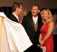 (left to right) Bill DeFries, Dave and Ellen Brixby, all from Springboro talk after looking at a Montreal Expos jersey signed by Gary Carter at the 17th Artemis Center Gala, Saturday night.