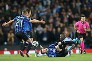 Manchester City defender Benjamin Mendy (22) leaves Atalanta forward Josip Ilicic (72) in pain after his tackle. Manchester City defender Benjamin Mendy (22) gets a yellow card for the challenge. during the Champions League match between Manchester City and Atalanta at the Etihad Stadium, Manchester, England on 22 October 2019.
