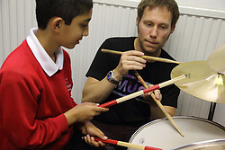 Visually impaired boy being given drumming lessons at Mysight charity, Nottingham.