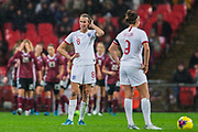 Jill Scott (England) and Jody Taylor (England) keen to get started again while Germany FC players continue to celebrate Klara Bühl (Germany) goal scored in the 90' during the International Friendly match between England Women and Germany Women at Wembley Stadium, London, England on 9 November 2019.