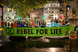 © Licensed to London News Pictures. 07/10/2019. London, UK. Extinction Rebellion protesters erect tents in and around Trafalgar Square . Photo credit: George Cracknell Wright/LNP