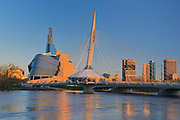 Canadian Museum for Human Rights (CMHR), Esplanade Bridge and Winnipeg skyline at sunrise