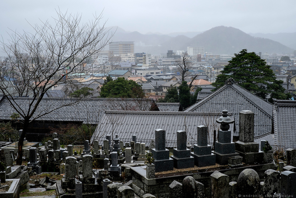 Graveyard overlooking the city at Hosshinji zen monastery. <br /> Obama city is a city on the Japan sea and has become quite famous during the US elections when Obama was elected president of the US, as they campaigned for him. The city has many Buddhist temples as it is on the route that Buddhism followed on its way to Japan.
