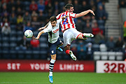 Preston North End midfielder Josh Harrop (10) andStoke City defender Tom Edwards (2) challenge for the high ball during the EFL Sky Bet Championship match between Preston North End and Stoke City at Deepdale, Preston, England on 21 August 2019.