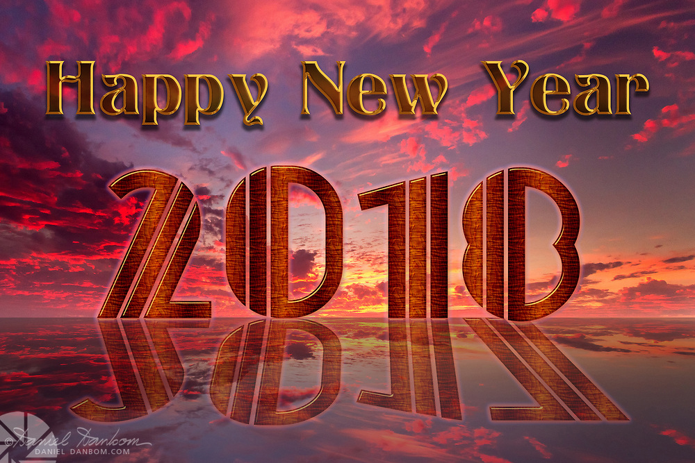 Happy New Year graphic panel, with transitionof the year 2017 to 2018 refected in a sunset/sunrise sky