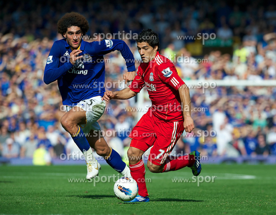 01.10.2011, Goodison Park, Liverpool, ENG, PL, Everton FC vs Liverpool FC, im Bild Liverpool's Luis Alberto Suarez Diaz in action against Everton's Marouane Fellaini during the Premiership match at Goodison Park, EXPA Pictures © 2011, PhotoCredit: EXPA/ Propaganda/ *** ATTENTION *** UK OUT!