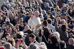 October 19, 2016 - Vatican City, Vatican - Pope Francis waves to the crowd as he is driven around St. Peter's Square ahead of his weekly general audience, at the Vatican, 19 October, 2016. (Credit Image: © Massimo Valicchia/NurPhoto via ZUMA Press)