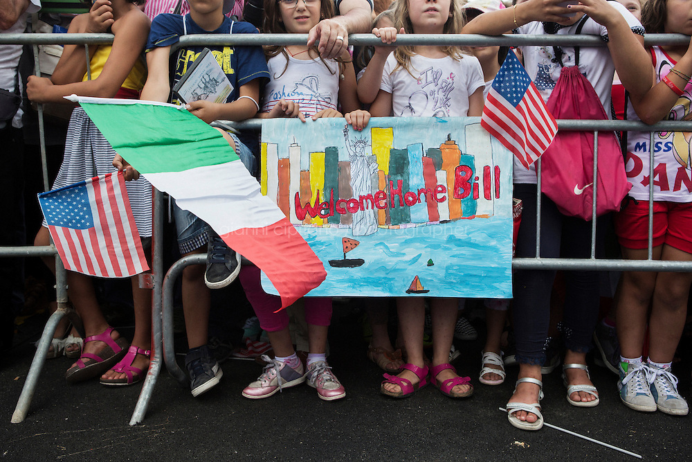 GRASSANO, ITALY - 24 JULY 2014: Children, who have prepared a drawing to donate to the Mayor of New York Bill de Blasio, attend a ceremony to celebrate his arrival  in Grassano, his ancestral home town in Italy, on July 24th 2014.<br /> <br /> New York City Mayor Bill de Blasio arrived in Italy with his family Sunday morning for an 8-day summer vacation that includes meetings with government officials and sightseeing in his ancestral homeland.