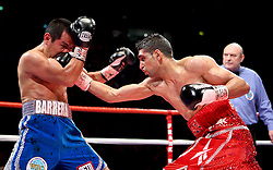 A battered and bloody Marco Antonio Barrera bleeds heavily as Amir Khan lands a right cross during the WBA and WBO Inter-Continental Lightweight title fight between Amir Khan and Marc Antonio Barrera at the MEN Arena on March 14, 2009 in Manchester, England.