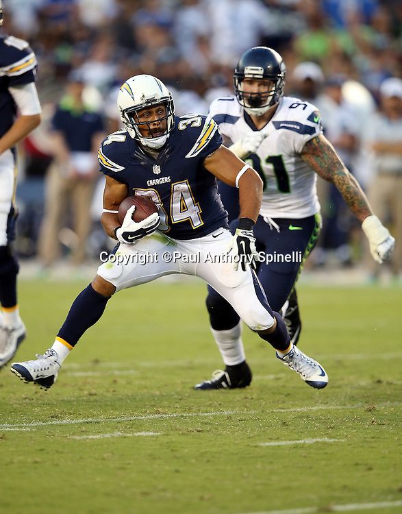 San Diego Chargers running back Donald Brown (34) runs the ball in the third quarter during the 2015 NFL preseason football game against the Seattle Seahawks on Saturday, Aug. 29, 2015 in San Diego. The Seahawks won the game 16-15. (©Paul Anthony Spinelli)