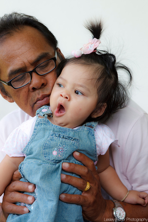 Portrait of a Thai grandfather and his grandaughter