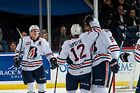 KELOWNA, CANADA - MARCH 9:  Kyrell Sopotyk #12, Montana Onyebuchi #5 and Brodi Stuart #17 of the Kamloops Blazers celebrate a second period goal against the Kelowna Rockets on March 9, 2019 at Prospera Place in Kelowna, British Columbia, Canada.  (Photo by Marissa Baecker/Shoot the Breeze)