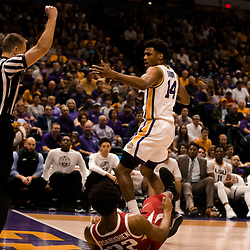 Feb 2, 2019; Baton Rouge, LA, USA; LSU Tigers guard Marlon Taylor (14) reacts after drawing a foul against Arkansas Razorbacks forward Gabe Osabuohien (22) during the second half at the Maravich Assembly Center. Mandatory Credit: Derick E. Hingle-USA TODAY Sports
