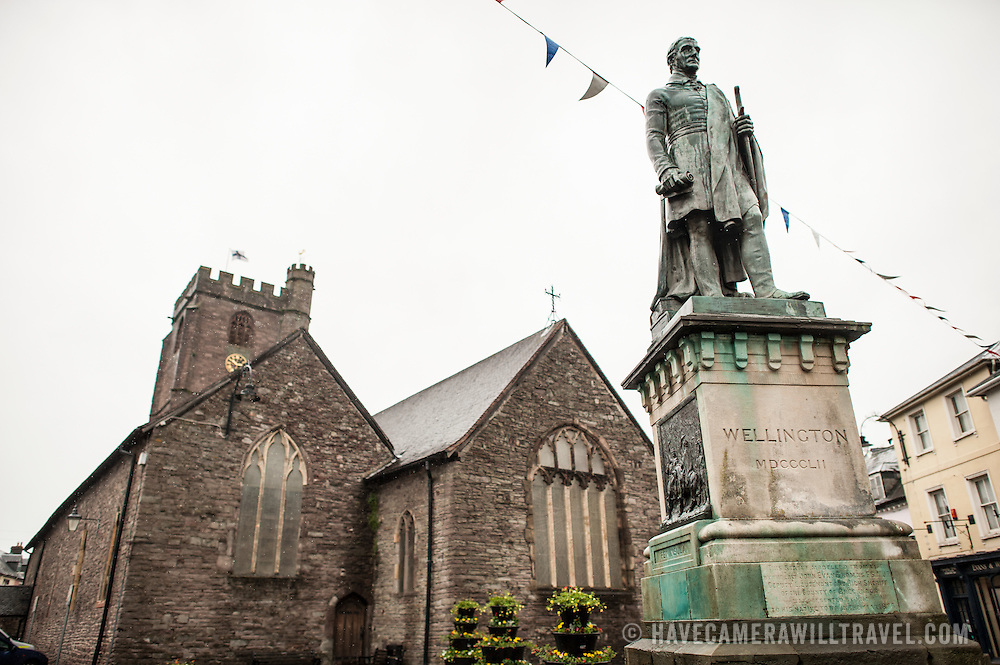 A statue of the Duke of Wellington stands in front of the Parish Church of St Mary's in Brecon, Wales, as rain falls.