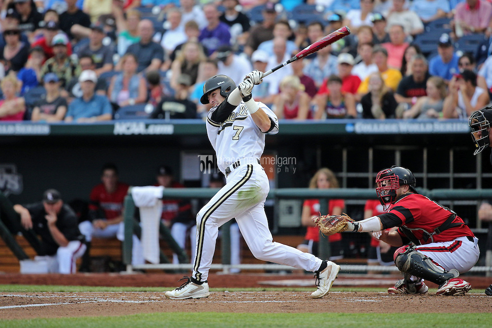 Dansby Swanson #7 of the Vanderbilt Commodores bats during Game 2 of the 2014 Men's College World Series between the Vanderbilt Commodores and Louisville Cardinals at TD Ameritrade Park on June 14, 2014 in Omaha, Nebraska. (Brace Hemmelgarn)