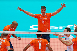 09-08-2019 NED: FIVB Tokyo Volleyball Qualification 2019 / Netherlands, - Korea, Rotterdam<br /> First match pool B in hall Ahoy between Netherlands - Korea (3-2) for one Olympic ticket / Nimir Abdelaziz #14 of Netherlands, Thijs Ter Horst #4 of Netherlands, Just Dronkers #6 of Netherlands