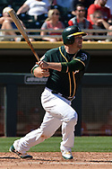 MESA, AZ - MARCH 09:  Stephen Vogt #21 of the Oakland Athletics hits a double driving in two runs against the Cincinnati Reds during the second inning of the spring training game at HoHoKam Stadium on March 9, 2017 in Mesa, Arizona.  (Photo by Jennifer Stewart/Getty Images)