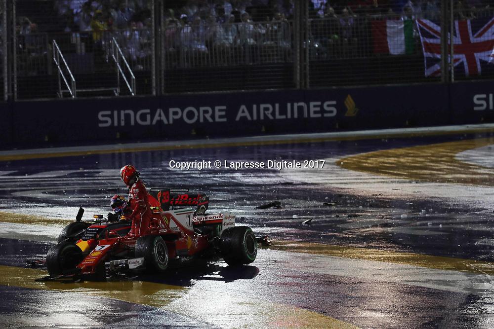 &copy; Photo4 / LaPresse<br /> 17/09/2017 Singapore, Singapore<br /> Sport <br /> Grand Prix Formula One Singapore 2017<br /> In the pic: crash, Kimi Raikkonen (FIN) Scuderia Ferrari SF70H and Max Verstappen (NED) Red Bull Racing RB13