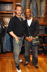 Left to right, actors TOM HARDY and ASHLEY WALTERS at a party to celebrate the launch of Diesel's new mens & womens fragrances 'Fule for Life' at their newly reopened store on the Kings Road, London on 13th September 2007.<br />